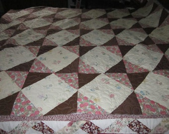 Brown and off white full size quilt