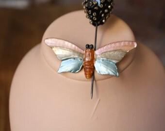 Iridescent butterfly brooch.