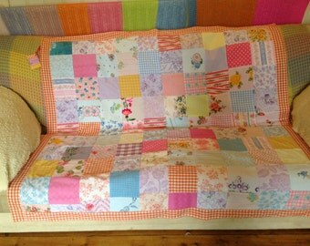 Bright and colorful vintage fabric patchwork throw. Original and unique.
