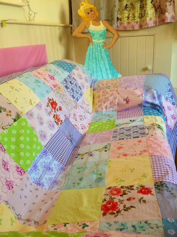 Vintage fabric patchwork bed cover. Pink, lilac, green, yellow, blue. Original and unique