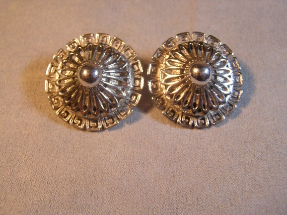 silver monet clip earrings with detailed filigree design and