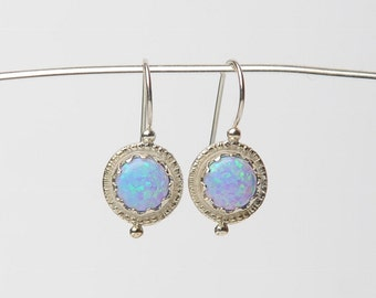 silver earrings with lab opal