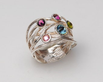 silver ring with 5 swarovski stones