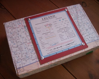 Decorated cigar box covered in a map.