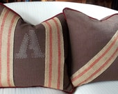 Brown cotton pillows with Dark Red Piping with handstitched burlap trim and handstitched monogram