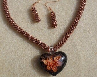 Black Glass Heart Pendant with Tangerine Flowers and Spiral Beaded Necklace