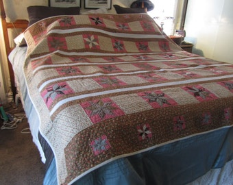 reduce price    antique quilt, browns, pinks, cream, hand quilted