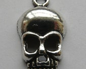 4 Antique Silver Skull Charms/Pendants
