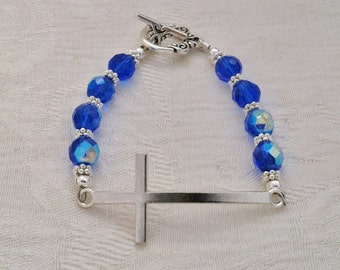 Silver Curved Cross Bracelet with Sapphire Swarovski 8mm Faceted Beads