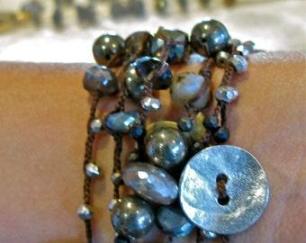 Mystic labradorite ,pyrite braided in brown linen