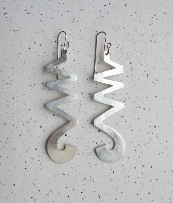 "Pair of  ""Long ZigZag""  silver earrings with a textured surface. Length 5.8 cm (2.3"") plus wire."