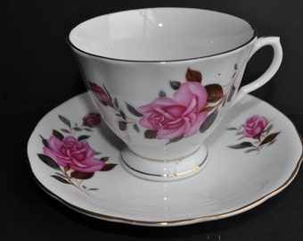 Beautiful Porcelain Cup and Saucer Adorned with Roses