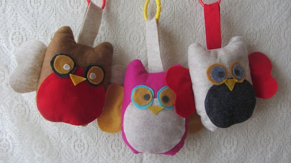 Hanging owl car seat toy.