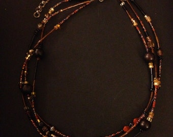 Tiger ebony wood and topaz glass beaded necklace.