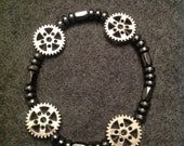 Hematite and metal beads.. Fits most wrists. (Men)