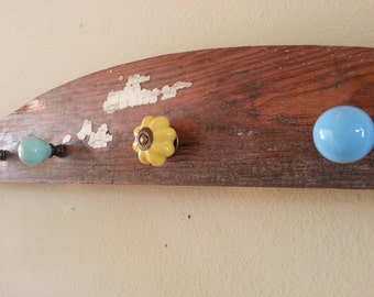 Reclaimed painted wood and ceramic knobs rack