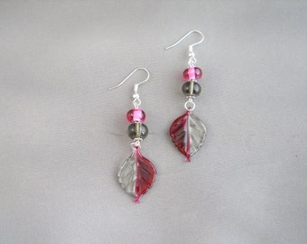 Red and clear glass leaf earrings.