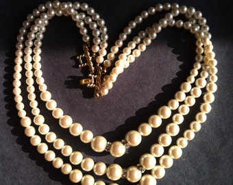 Vintage faux pearl necklace with rhinestone accents