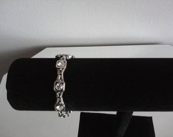 silver metal bracelet with clear glass stones