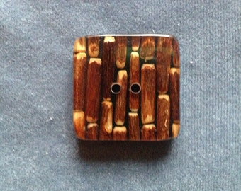 """Large square button. Twigs set in resin square 2-hole button. 1 1/4"""" (32mm). 1 pc."""