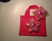Pink canvas bag matching hair clip.