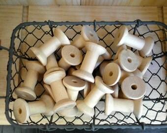 A set of 5 wooden spools