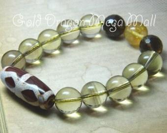 NIRVANA. 12 mm Lemon Quartz  Bracelet with Tibetan Dorje Dzi