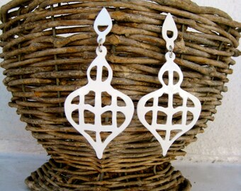 Big flashy earrings in white