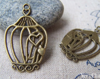 10 pcs of Antique Bronze Filigree Heart Bird Cage Charms 21x34mm A155