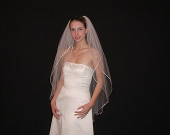 2 layers fingertip with rounded/rattail ribbon edging - 2 layer fingertip bridal veil. Ready to ship.