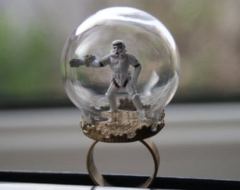 Glass terrarium dome ring, with Star Wars Stormtrooper.