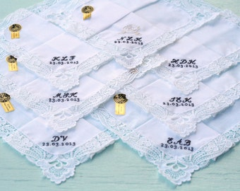 Hand embroidered, two initial monogrammed handkerchiefs.