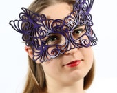 Rococo lacy mask in purple leather