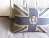 handprinted muted royal blue hessian union jack flag cushion with  logo thistle overlay