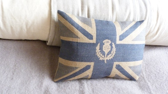 handprinted muted royal blue hessian union jack flag cushion with  logo thistle overlay