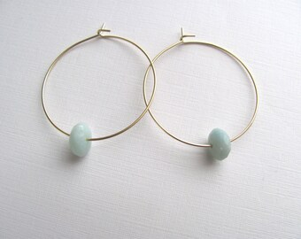 Gold hoop earrings with single aqua amazonite beads