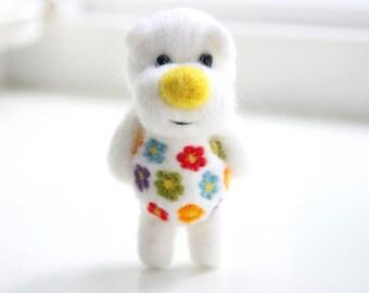 White felt bear with flowers