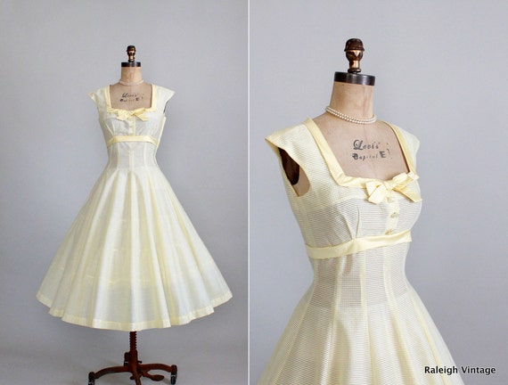 full skirt yellow vintage 50's dress for garden party with square neckline and bow