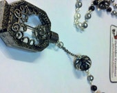 Rosary Style Necklace With Bottle
