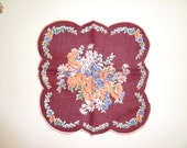 Vintage cranberry colored hanky with peach colored and blue and white flowers