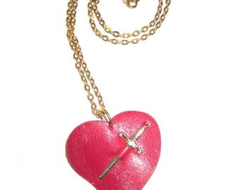Daggered Red leather heart....