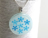 Blue Flowers on a Round Glass Pendant