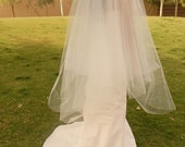 Bustle added to cathedral veil