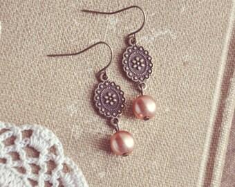 flower and pearl earrings.
