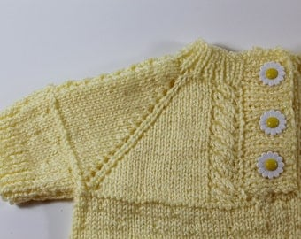 Yellow short sleeve baby sweater with cables