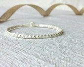 tiny faceted silver beads dainty layering wrap bracelet. max.