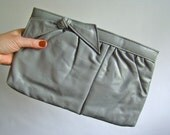 vintage leather-look light gray bow clutch