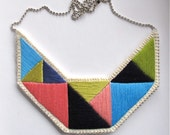 Statement bib necklace hand embroidered in lime green blues and pinks hand embroidered geometric design