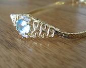Vintage gold and aquamarine stone bracelet.  Avon. Filigree.