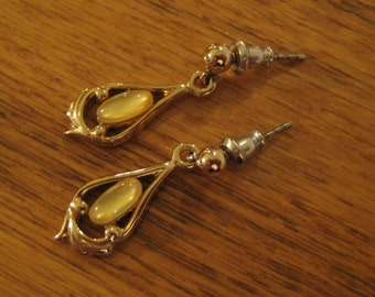 Vintage silver moonstone earrings.  Pierced earrings. Costume jewelry.